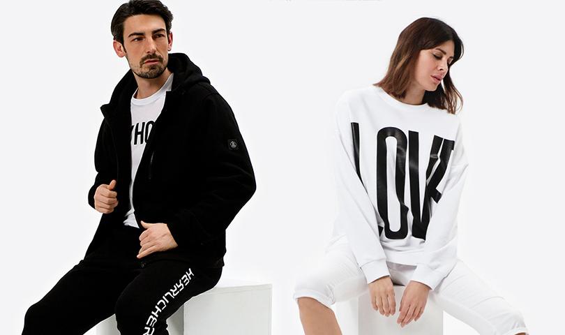 Mann und Frau in sportlicher Herrlicher Bekleidung